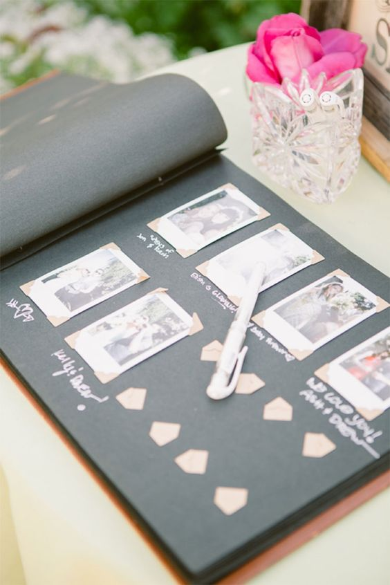 a traditional wedding guest book with Polaroids attached is a stylish idea, add a pen for guests to wish you something