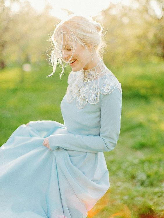a unique powder blue wedding dress with a high embellished neckline looks wow