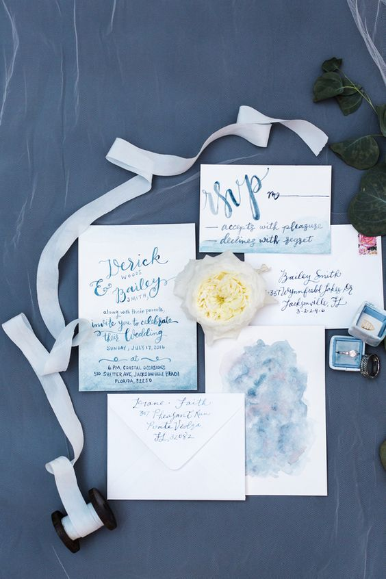 a unique wedding invitation suite with blue ombre, blue calligraphy is perfect for a beach or coastla wedding