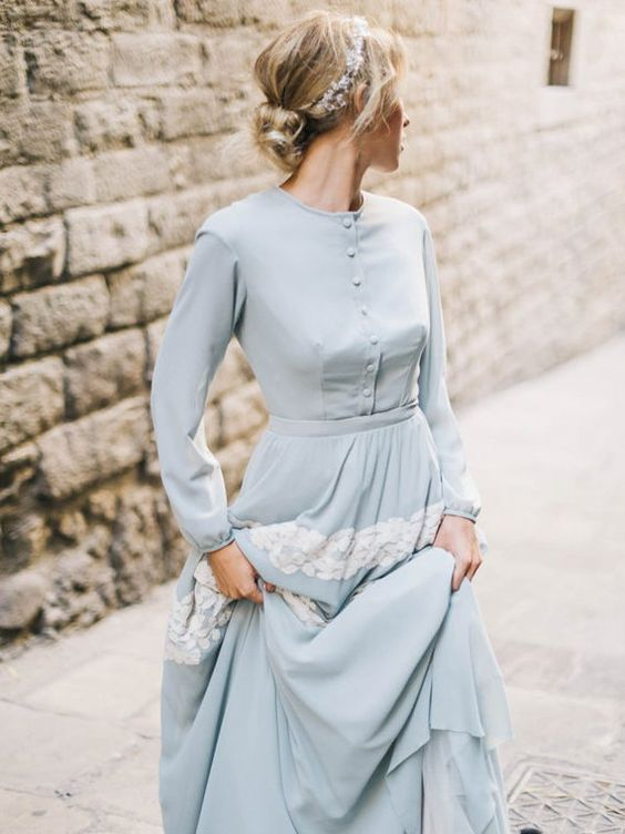a vintage-inspired powder blue wedding dress with buttons, long sleeves and white lace