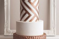 a white and copper wedding cake with textural tiers, with a geometric one is a stylish and refined idea for a modern wedding