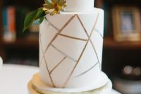 a white and gold geometric wedding cake with sugar blooms is a stylisha nd timeless idea for a modern wedding