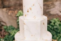 a white and grey marble wedding cake with round and a hexagon tier, with gold leaf is a lovely and cool idea for a modern wedding