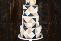 a white, gold, blush and black triangle wedding cake with gold dip is a chic and lovely idea for a modern and bold wedding