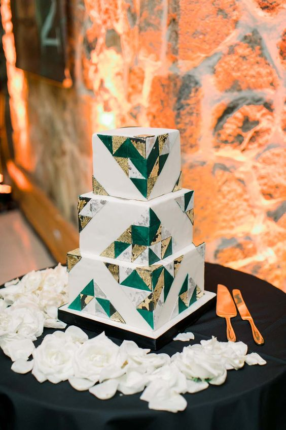 a white square wedding cake with gold, grey marble and emerald triangles covering it is a chic and cool idea to rock