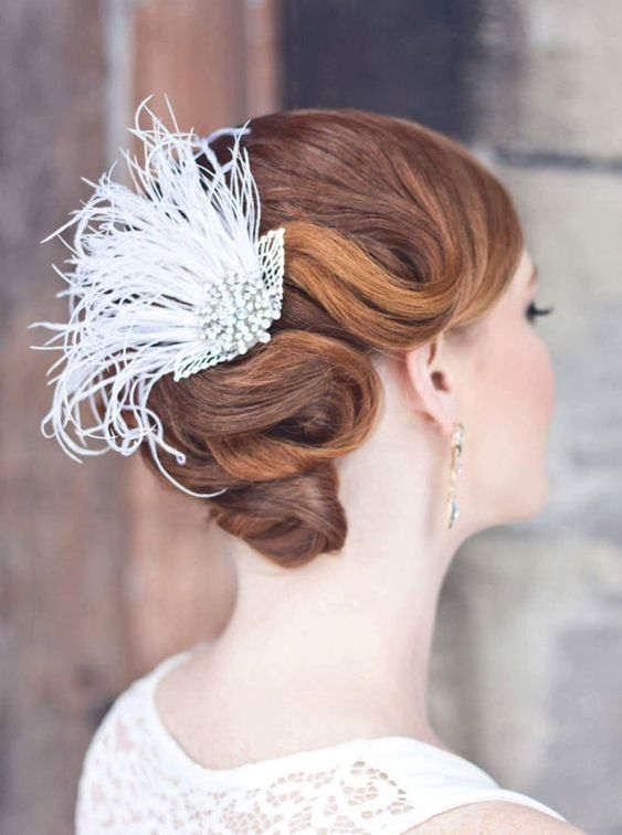 an art deco bridal hairpiece of crystals and feathers is always a great idea for a 20s bride