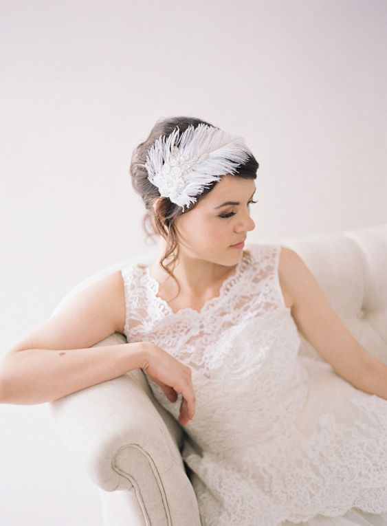 an embellished feather headpiece is a fabulous and chic wedding headpiece to rock