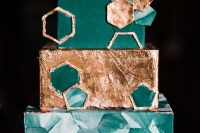 an emerald and gold squre wedding cake with green marble hexagons, a gold foil tier, emerald and gold hexagons is amazing
