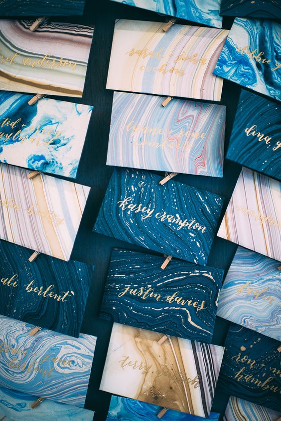 beautiful blue and gold marbled escort cards look gorgeous and will fit a beach, coastal or nautical wedding