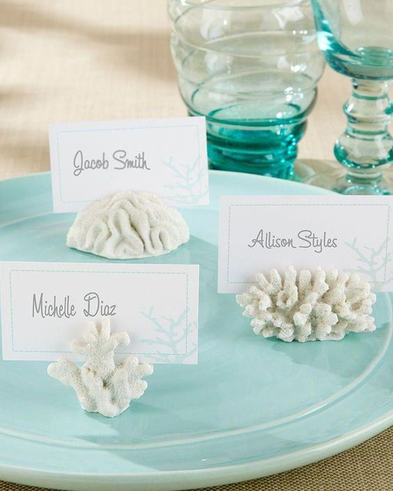 corals holding escort or seating cards are always nice for a beach, coastal or nautical wedding