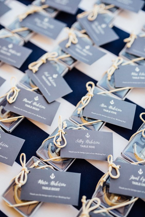 mini anchor escort cards with rope and tags with names will double as nice nautical wedding favors
