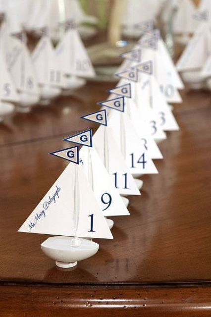 mini boats with names written on sails and your monograms are nice for nautical and coastal weddings
