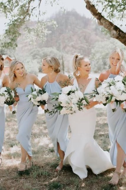 mismatching powder blue bridesmaid maxi dresses are a sweet and cute idea for spring and summer weddings