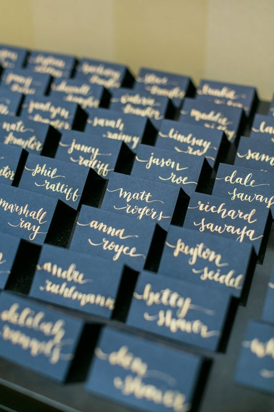 navy and gold escort cards will match your wedding decor