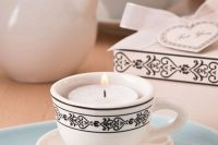 place some tealights into your vintage teacups to make them cooler favors and add escort cards to them