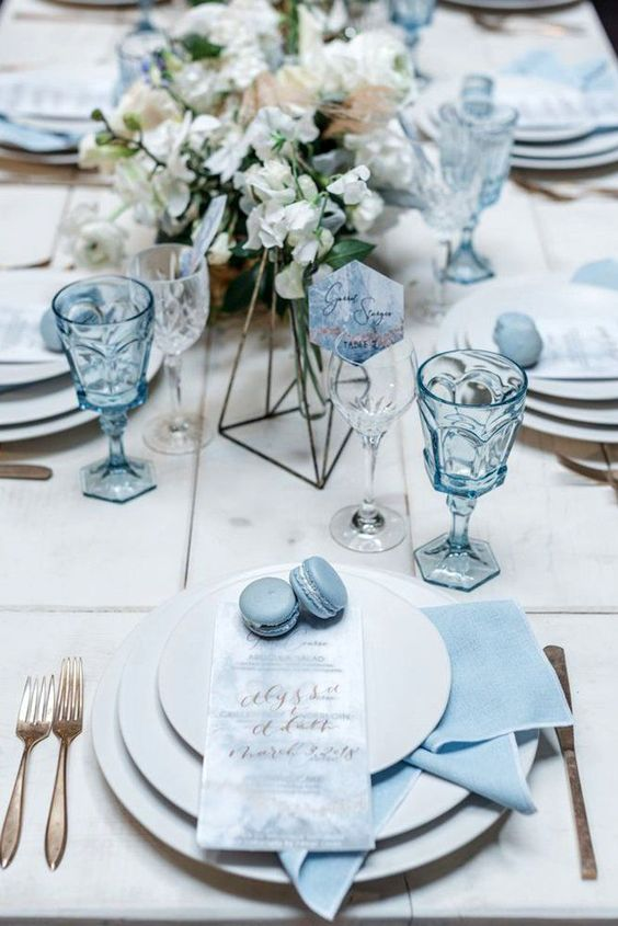 powder blue napkins, macarons, watercolor menus, glasses, pastel flowers and copper cutlery