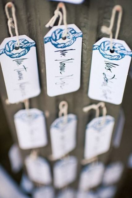 tags with printed navy rope and names are cool and stylish escort cards for a beach or nautical wedding
