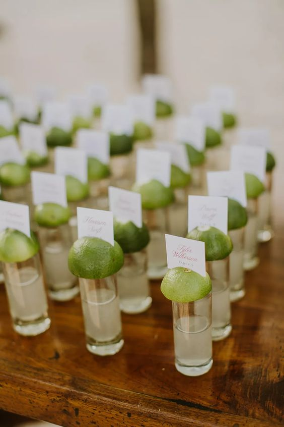 tequila and lime shots with escort cards on top are ideal for a tropical beach wedding
