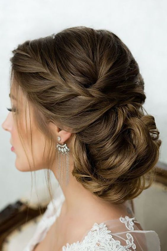 a beautiful braided low updo with a braided top and some locks down is a very chic and cool option