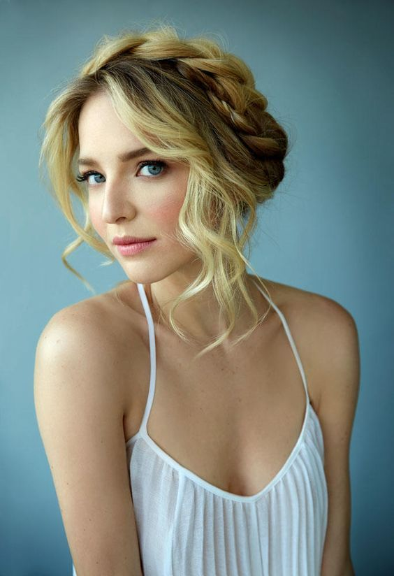 a braided halo updo with some waves farming the face is an irresistible and sexy option