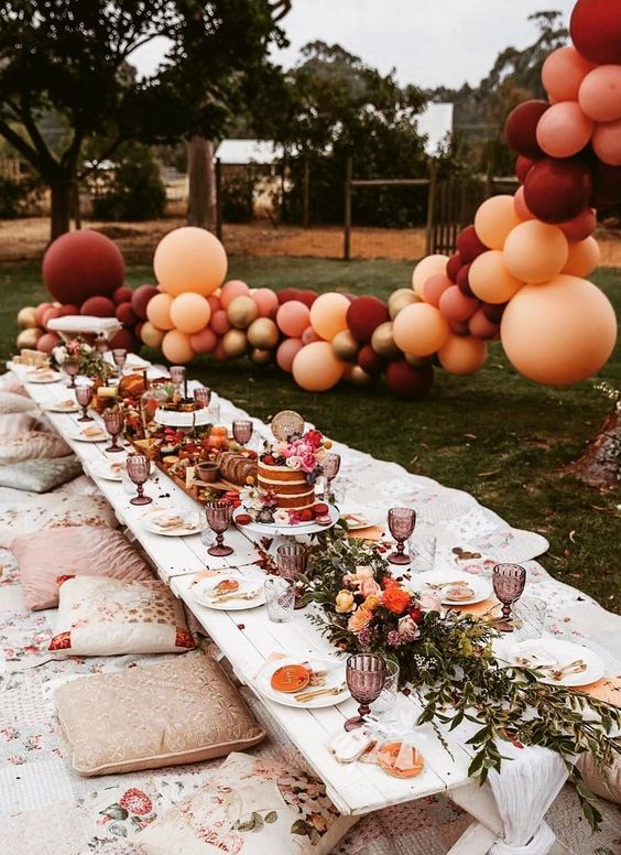 a cool wedding picnic with a grazing table