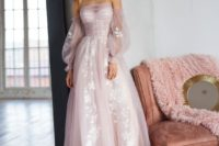 a blush pink wedding dress that looks awesome