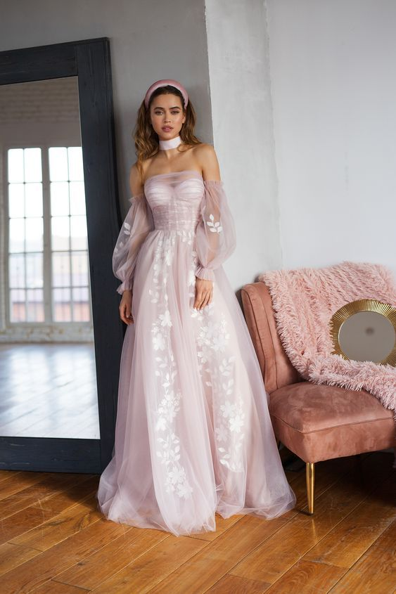 a bush pink wedding dress with off the shoulder puff sleeves, an illusion neckline and white appliques