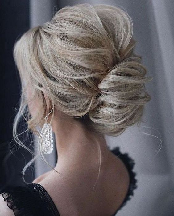 a classic and very elegant low chignon updo with a volume on top and some locks down is very chic