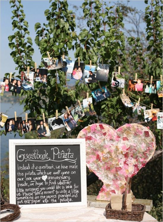 a colorful and shiny heart-shaped pinata wedding guest book is a lovely alternative to rock and it looks very cute and romantic