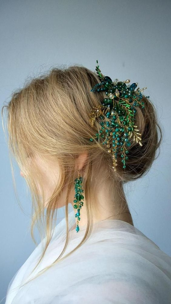 a cool updo with some mess and texture, with locks down and a jaw-dropping gold and emerald hairpiece is wow