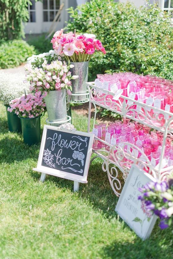 a flower bar for a garden bridal shower - each guest receives a vase and some fresh blooms that she picked