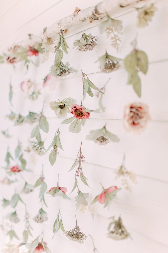 a hanging with fresh blooms and leaves is a pretty way to decorated your garden bridal shower if blooms around aren't enough