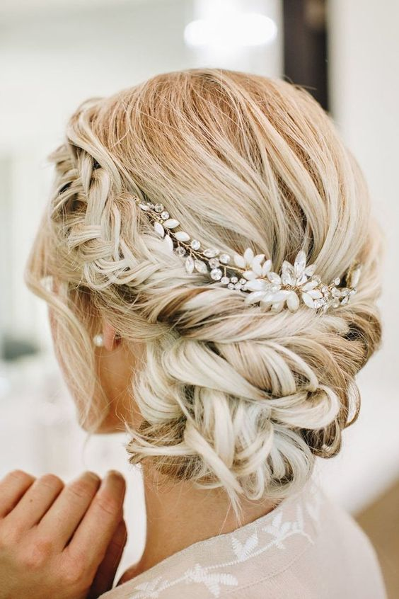a low updo with a volume on top, a braided halo and a low bun plus a pearl and rhinestone headpiece