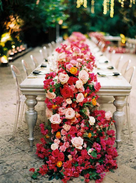 a lush bright floral garland will substitute any centerpiece and will add a refined and trendy touch to the tablescape