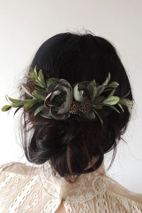 a messy and textural low updo with some greenery is a great idea for a woodland or boho bride
