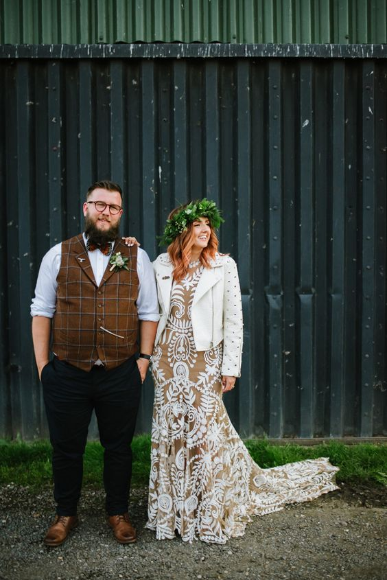 a nude mermaid wedding dress with white lace and a train for a boho barn bride