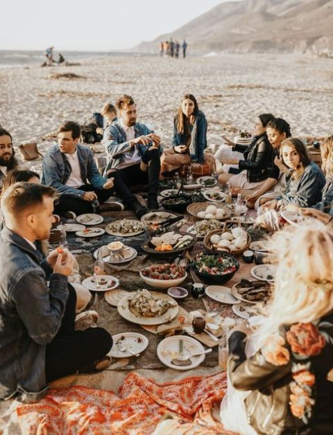 a relaxed beach boho wedding picnic with blankets, lots of delicious food and laid-back vibes