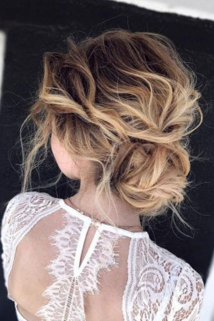 a very messy and wavy updo with a wavy top and a low bun is an effortlessly chic option to go for