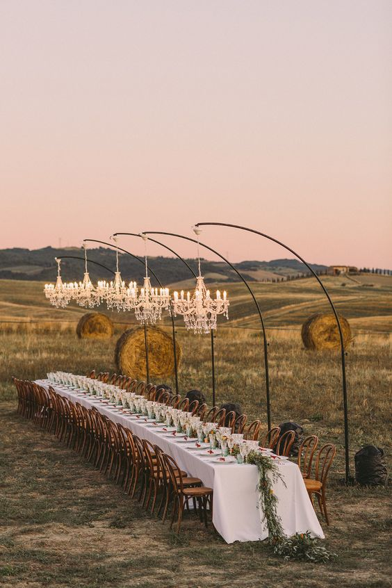 an outdoor barn-inspired long reception tables
