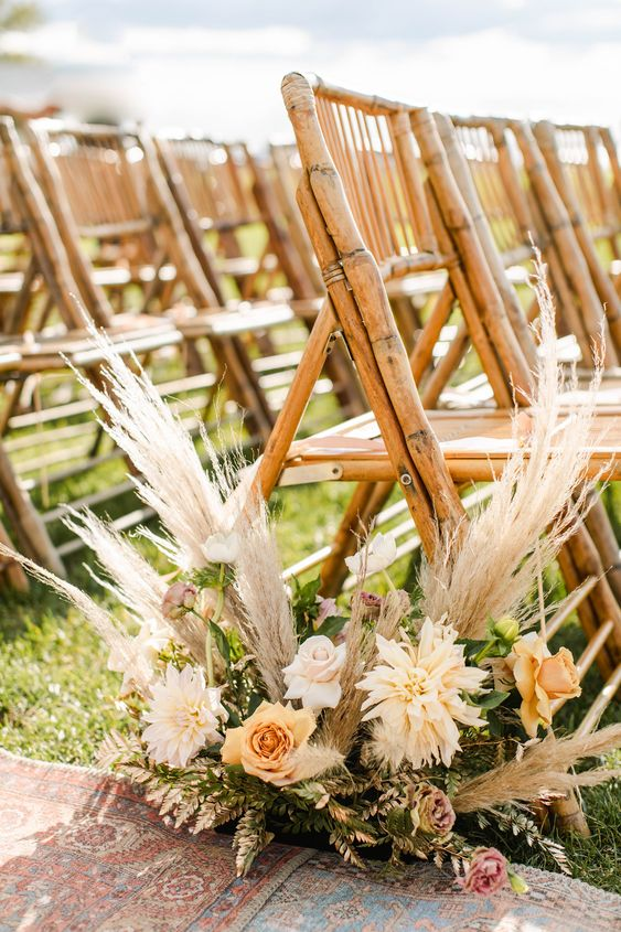 a beautiful floral arrangement of white and yellow blooms, foliage and pampas grass is a cool idea for the fall