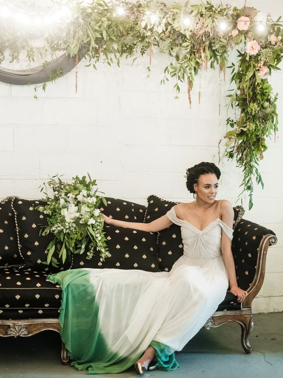 a beautiful spaghetti strap dip dye with green wedding dress with off the shoulder sleeves and silver shoes