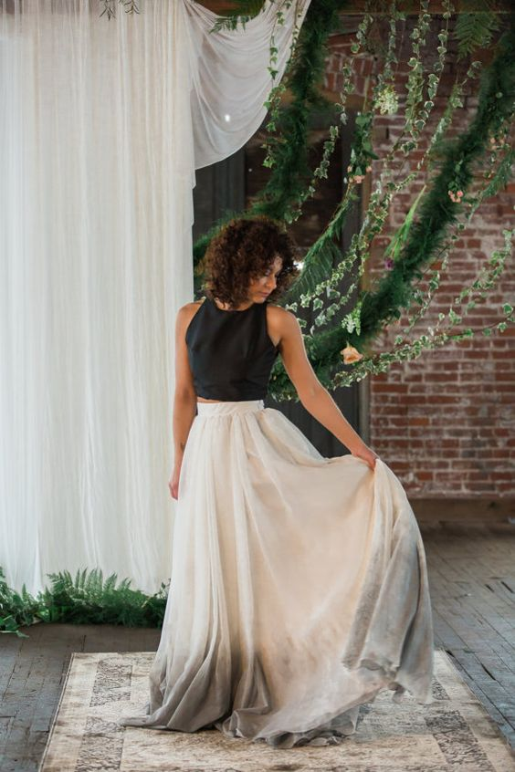 a black plain sleeveless top, a white and grey dip dye skirt with a train is a contrasting idea for a modern bride