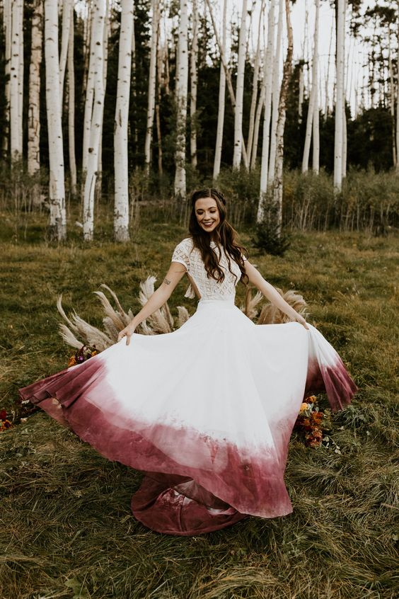 a boho wedding dress with a lace bodice with short sleeves and a dip dye burgundy and white skirt