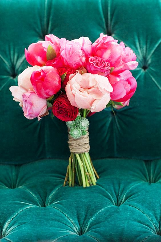 a bold and pretty wedding bouquet of coral, pink and blush peonies and succulents is amazing for summer