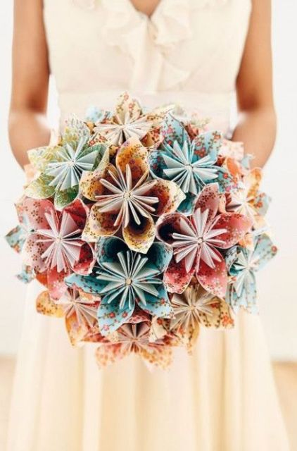 a bold paper wedding bouquet of colorful paper blooms is a very creative and eco-friendly idea, reuse some paper you have at hand