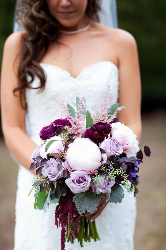 a bold wedding bouquet of lilac roses, blush peonies, purple ranunculus, greenery and astilbe is amazing for fall