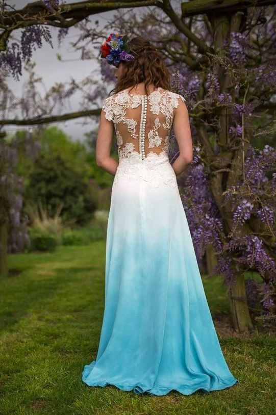 a bold wedding dress with a dip dye blue skirt, a lace bodice with cap sleeves and a button row on the back