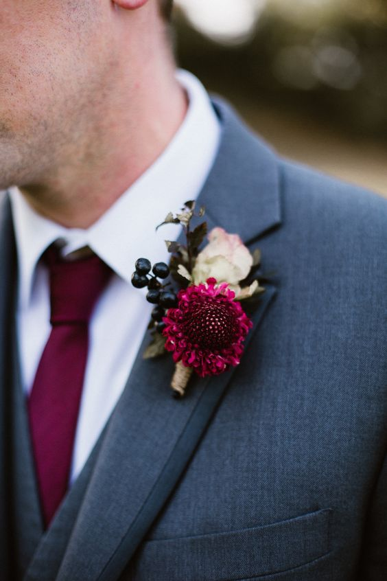a bright fall wedding boutonniere with a neutral and pink bloom and privet berries is bold fall classics to try