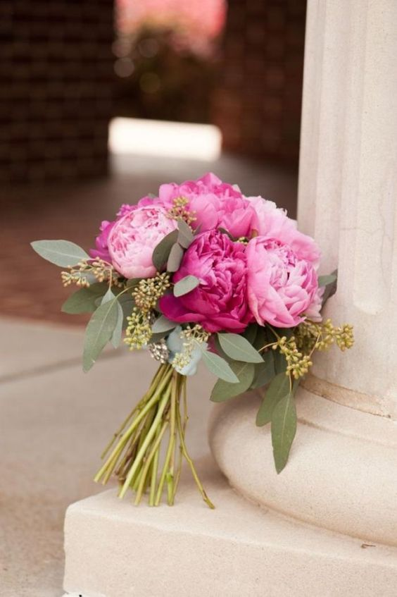a bright wedding bouquet of pink and hot pink peonies and some seeded eucalyptus is a lovely idea for a bold summer wedding
