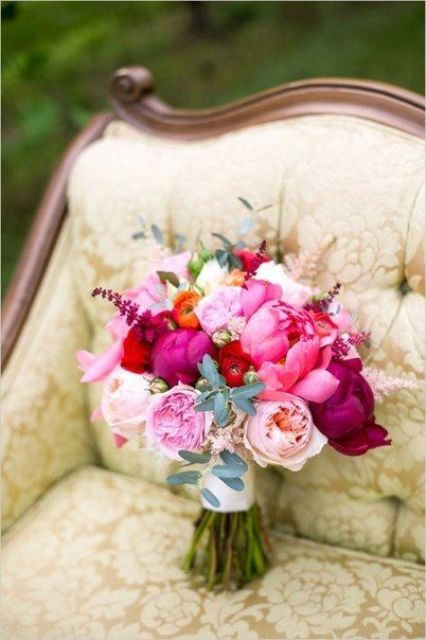 a colorful summer wedding bouquet of hot pink, white and blush peonies, purple blooms and greenery for a bright summer wedding